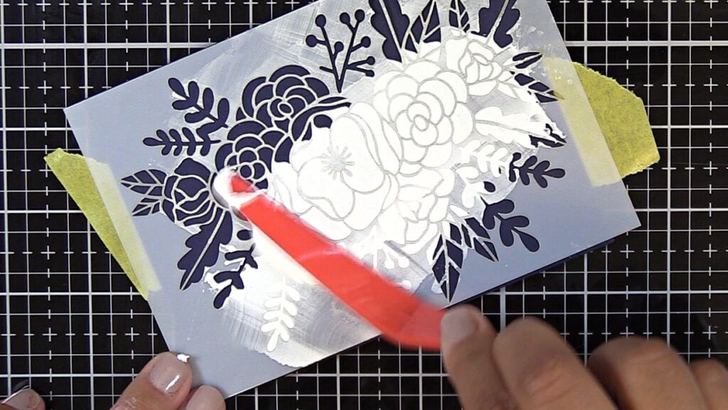 Spread embossing paste over Hedgehog Hollow May 2019 Floral Stencil