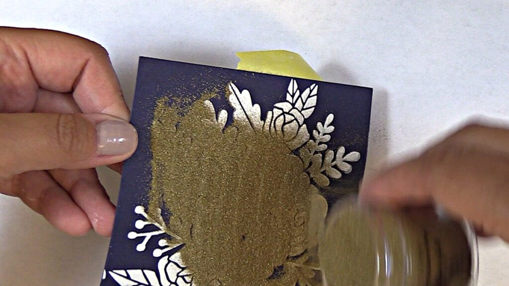 Generously apply Altenew Antique Gold Embossing Powder